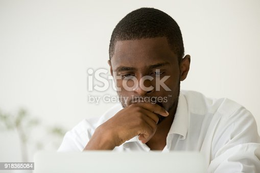 936117940 istock photo Focused african manager working on laptop thinking of problem solution 918365084