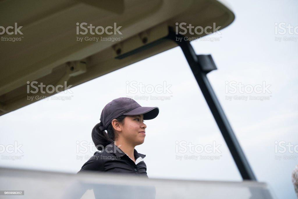 Gerichte Aziatische vrouwelijke golfer - Royalty-free Actieve levenswijze Stockfoto