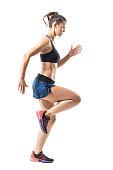 istock Focused athletic female sprinter movement run and looking ahead. 854374242
