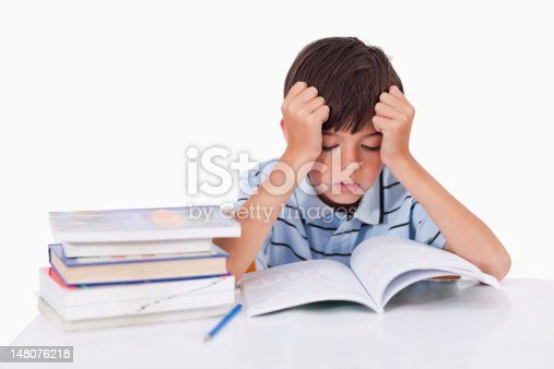 istock Focused boy learning his lessons 148076218