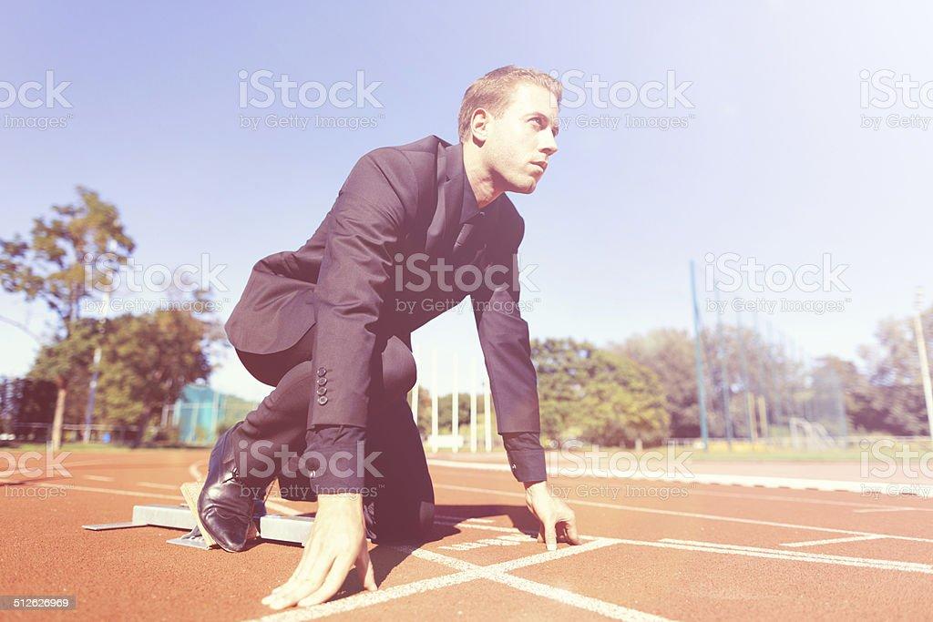focused businessman in starting block stock photo
