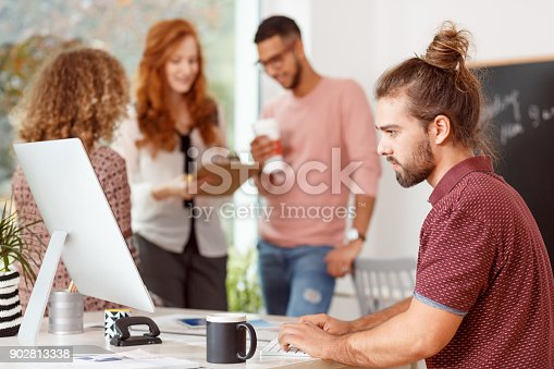 842214626istockphoto Focused businessman working at desk 902813338