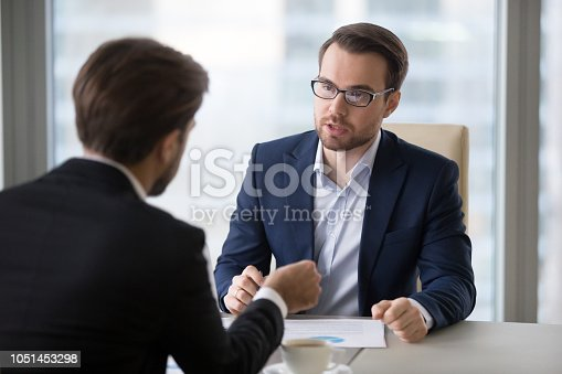 istock Focused businessmen negotiation on company strategies in office 1051453298