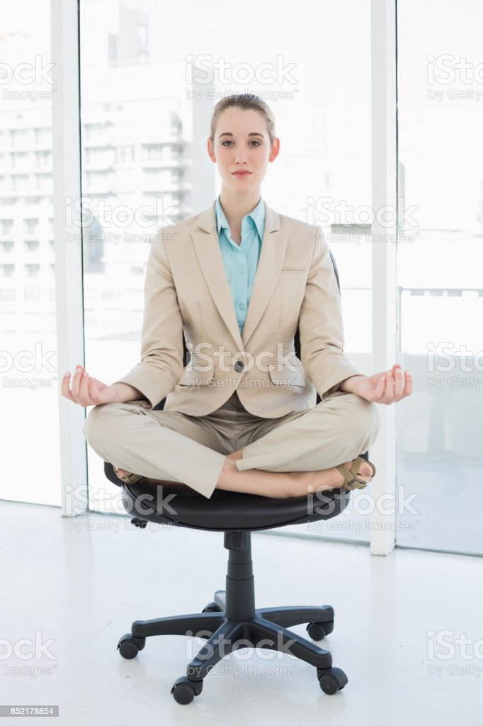 Fabulous Focused Chic Businesswoman Sitting In Lotus Position On Her Pabps2019 Chair Design Images Pabps2019Com