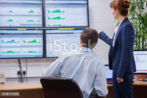 istock Focused colleagues analyzing result on their computer 518177475