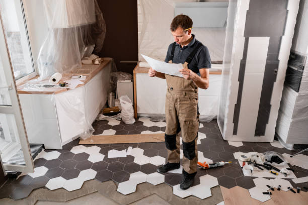 Focused diligent worker inspecting room and planning repairs work. repair of the dining room in the house, kitchen furniture, floor covering change. stock photo