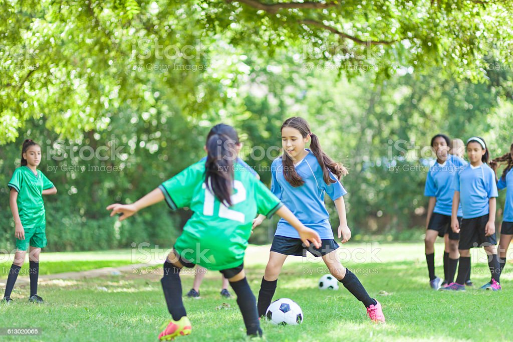 Focused female  soccer players face off stock photo