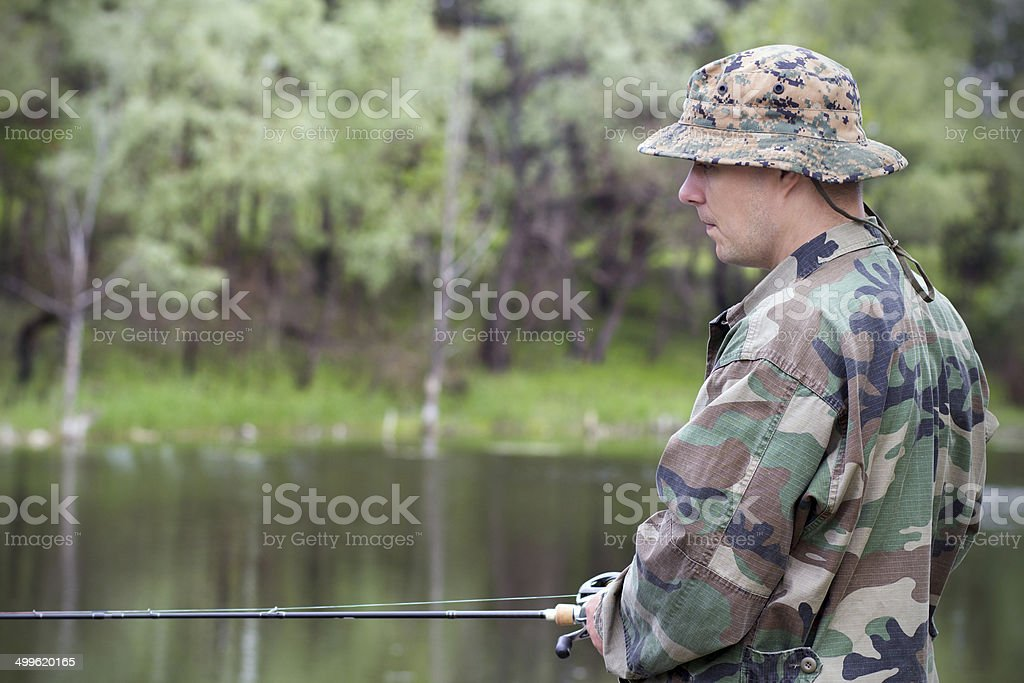 Focused fisherman with spinning royalty-free stock photo