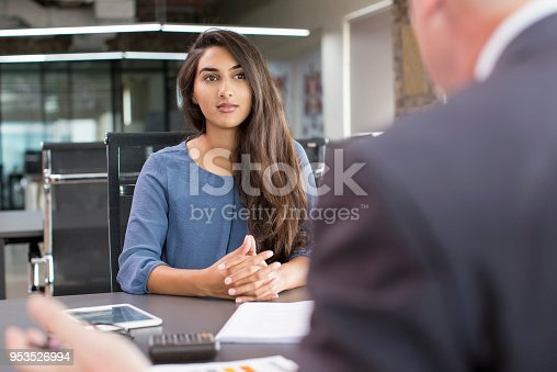 istock Focused Indian female customer meeting with financial advisor 953526994