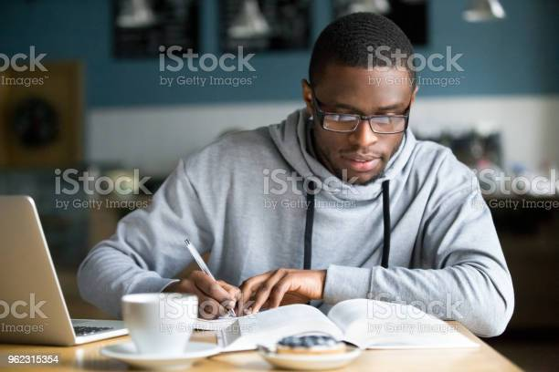 Focused millennial african student making notes while studying in picture id962315354?b=1&k=6&m=962315354&s=612x612&h=xxkart1 plyydwzbbik8bwtexr ebfieijkqvpxlm8i=