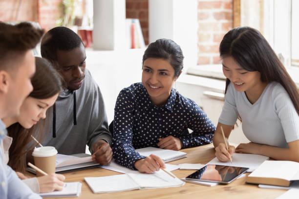 Focused multi national students sitting at desk studying together picture id1187643075?b=1&k=6&m=1187643075&s=612x612&w=0&h=xu3es7devnn8o qrstlnfoq nwxsss1sfs3 ulmknna=