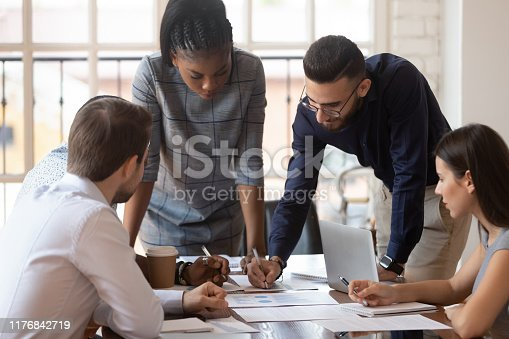 istock Focused multiracial corporate business team people brainstorm on paperwork 1176842719