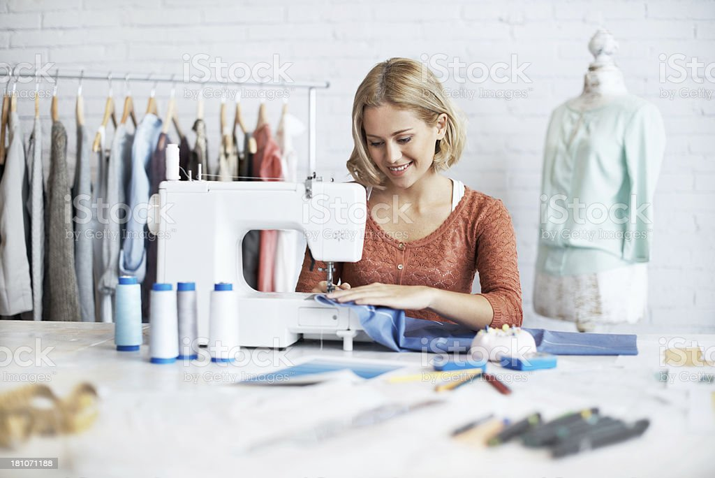 Focused of finishing her garment stock photo