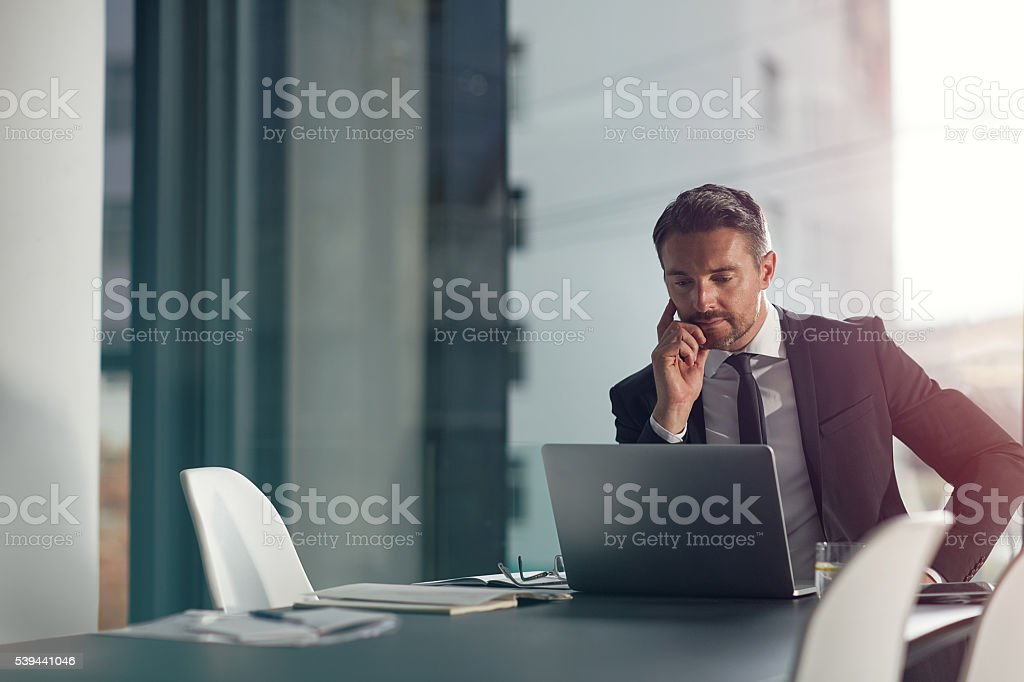 Focused on meeting his deadline stock photo