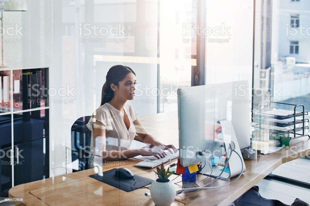 Focused on perfecting her work stock photo