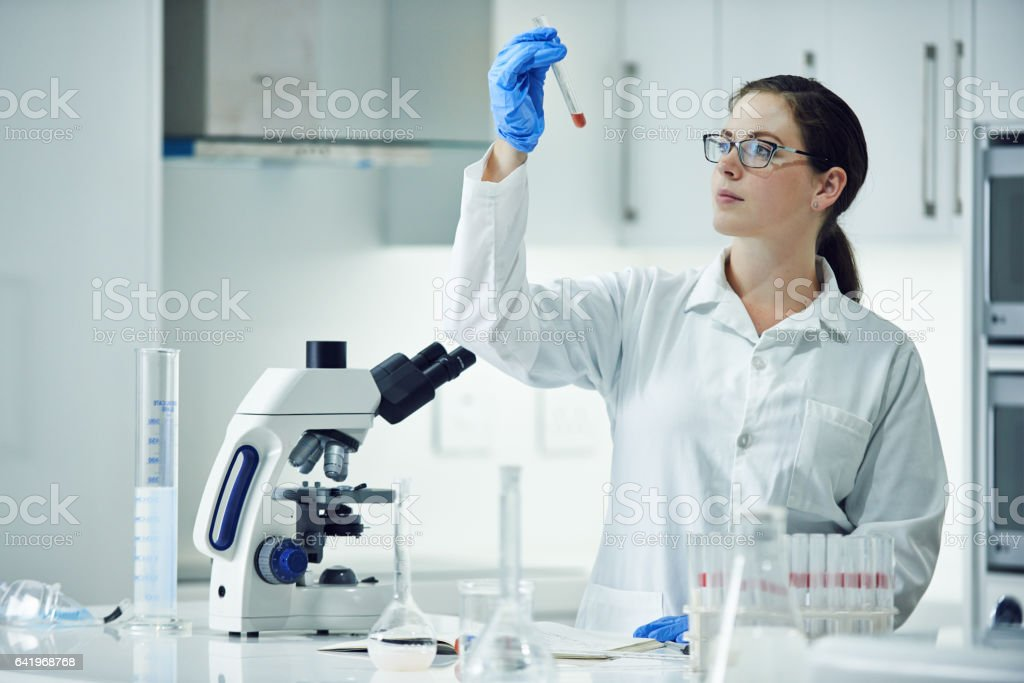 Focused on solving medical mysteries stock photo