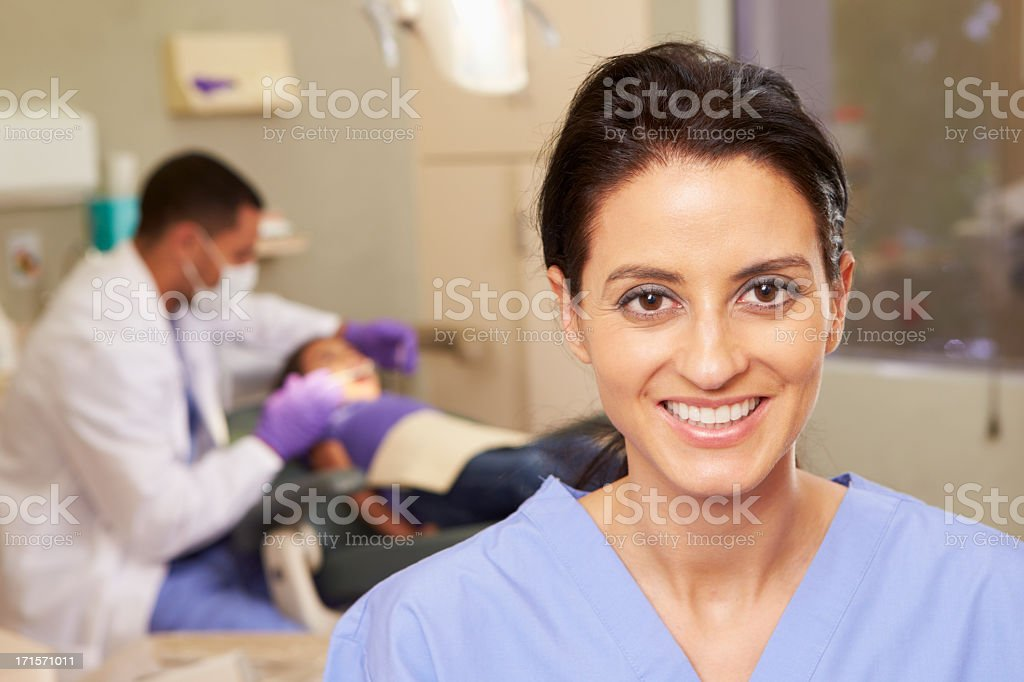 A focused shot of a dental hygienist stock photo