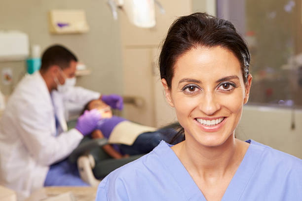 a focused shot of a dental hygienist - dental assistant stock photos and pictures