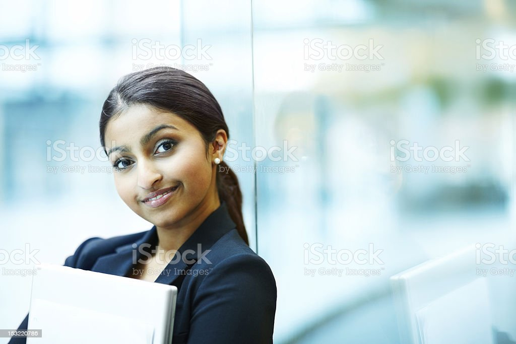 A focused shot of a woman smiling into the camera royalty-free stock photo