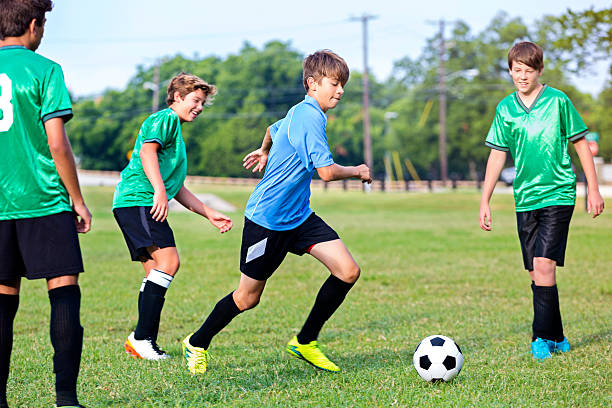 Focused soccer player during game stock photo