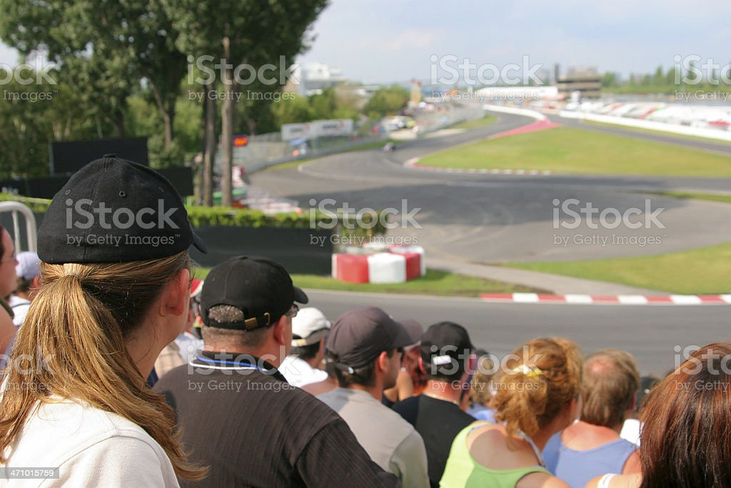 Focused Spectators at a car race royalty-free stock photo