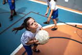 istock Focused student with disability playing basketball 1280874072