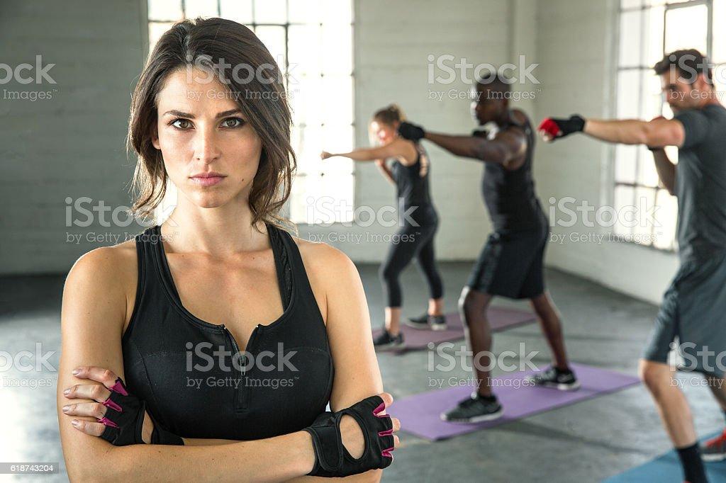 Focused tough female athlete portrait workout intense physical training team stock photo