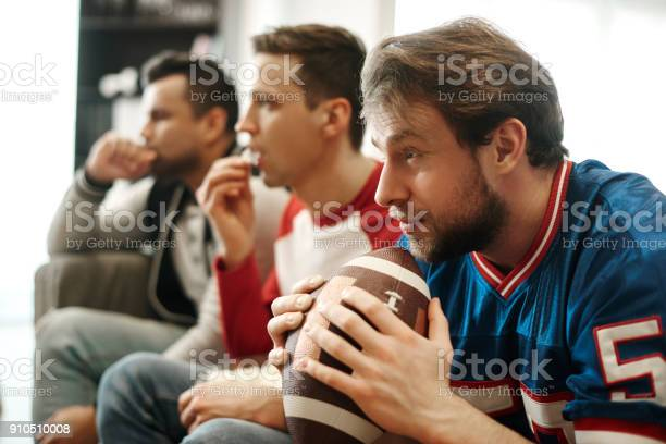 Focused watching football game at home picture id910510008?b=1&k=6&m=910510008&s=612x612&h=wysd q8njuxjc9kjsi vf5dtdsj76afd8l bnspbiym=