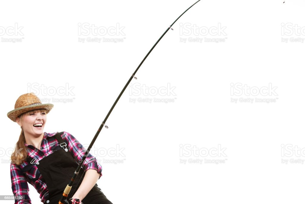 Focused woman in sun hat holding fishing rod foto de stock royalty-free