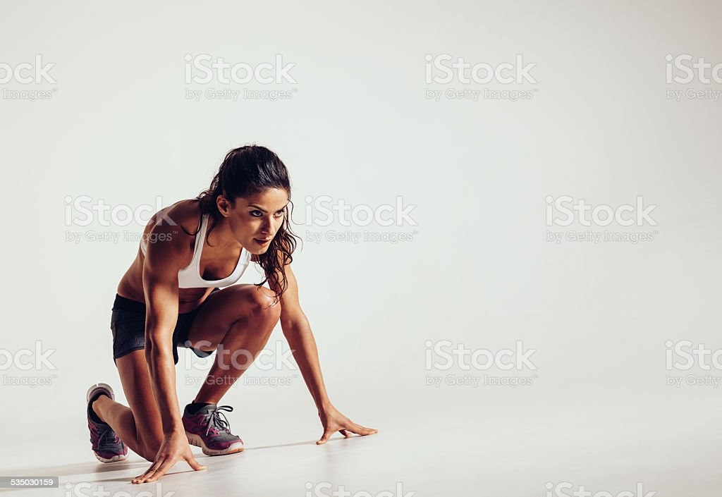 Focused woman ready for a run stock photo