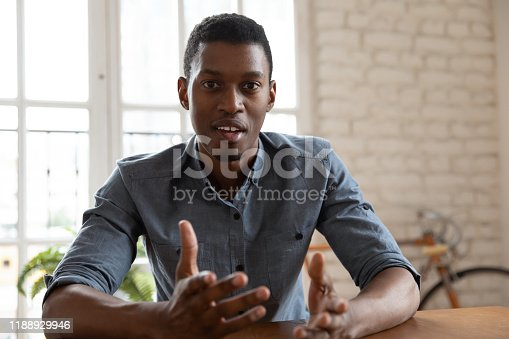 istock Focused young african american male speaker recording educational lecture. 1188929946