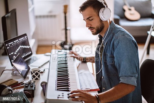 istock Focused Young Artist Playing Electric Piano 888275014
