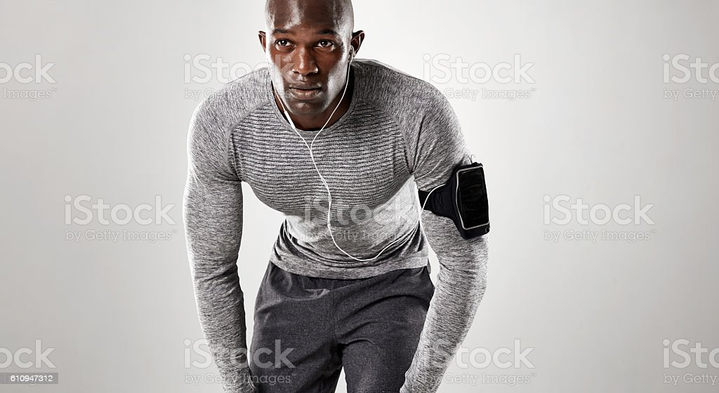 Focused young man ready for running stock photo