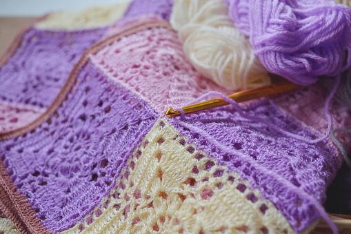 Focusing crochet hook on crochet pattern and yarns