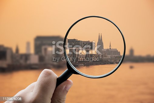 A magnifying glass focusing the city of Cologne, Germany