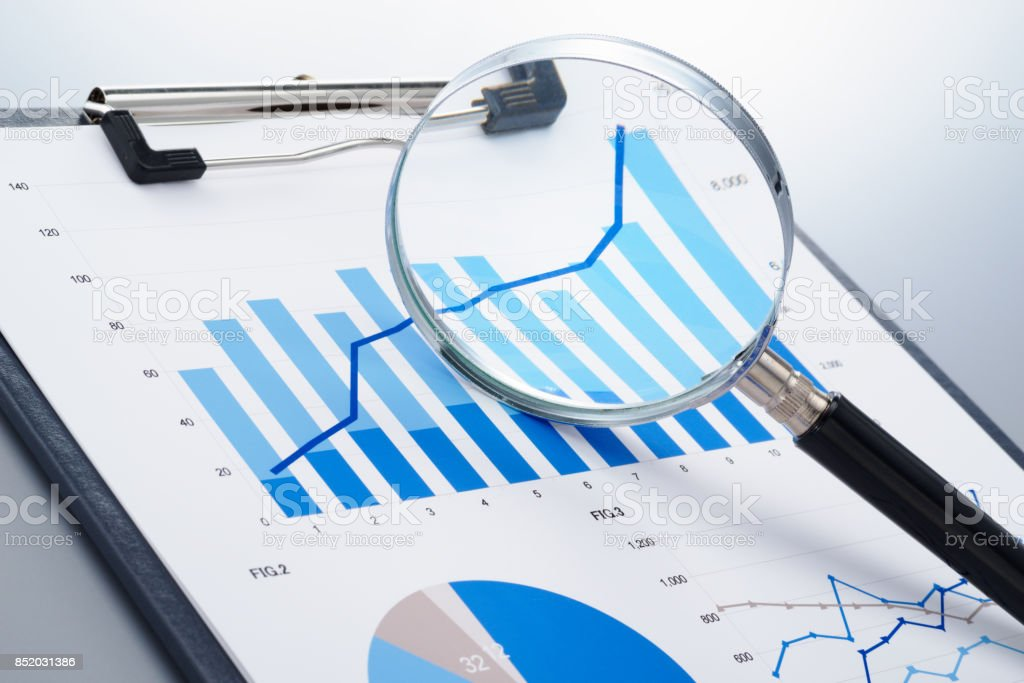 Focusing on growth potential. Reviewing report. stock photo