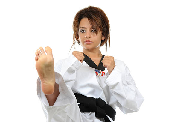 Focusing on her front kick stock photo