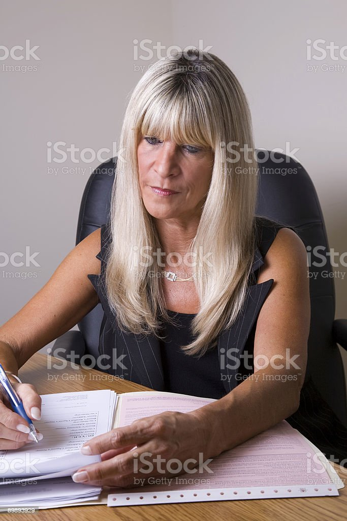 Focusing on the Paperwork royalty-free stock photo