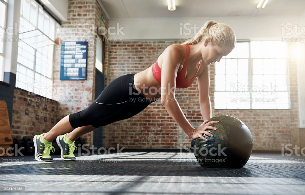 Focussed on her workout stock photo