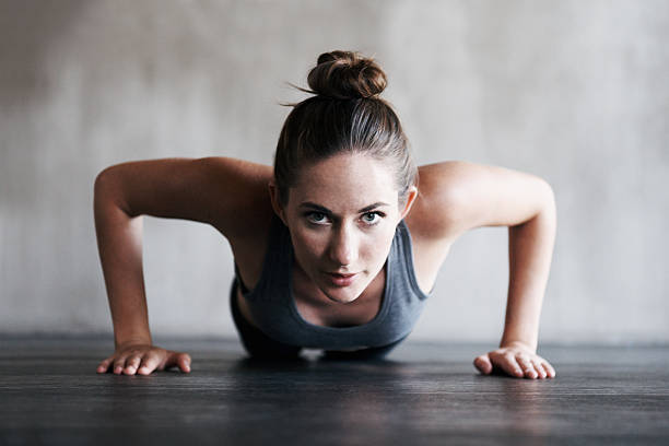 focussed on increasing her endurance - push up stock photos and pictures