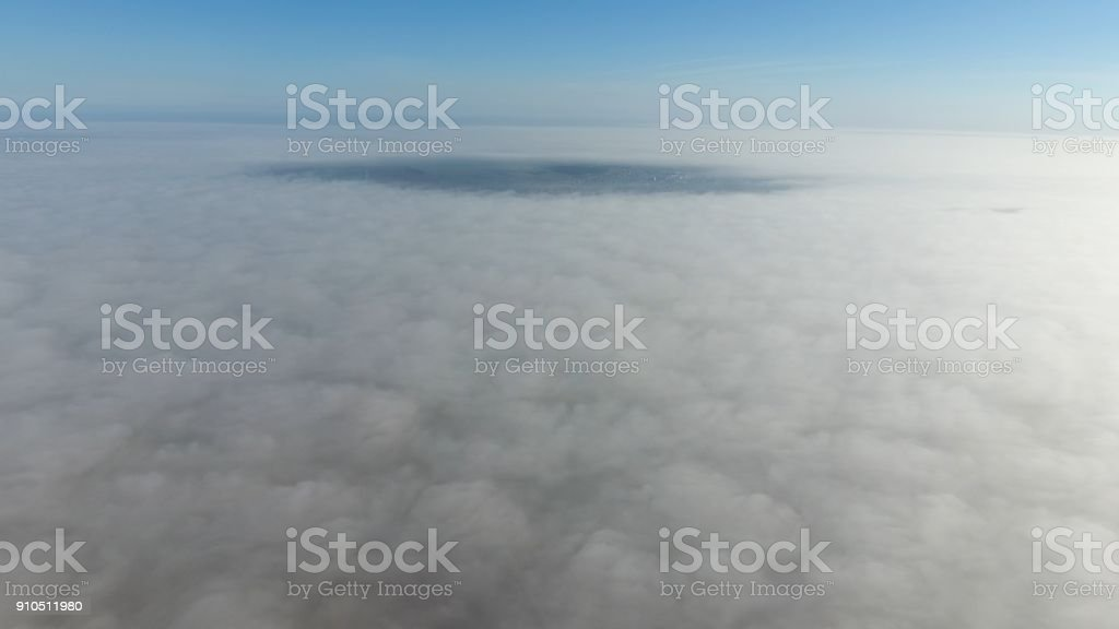 Fog above the ground. Top view of the fog. Low clouds. Morning mist...
