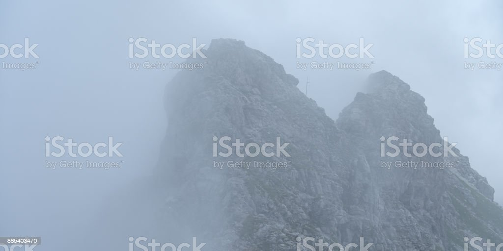 Fog at Hindelanger via ferrata in Allgäu Bavaria stock photo