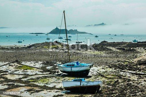 Boats at Low tide with fog at Saint-Servan-sur-Mer, Ille-et-Vilaine, Brittany, France.
