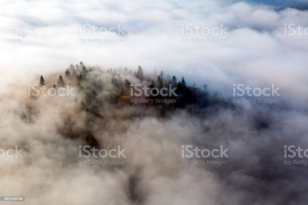Fog Clouds Summerland British Columbia Okanagan Valley Above the morning sunrise fog clouds over Okanagan Lake from Giant's Head Mountain located in Summerland, British Columbia, Canada. Above Stock Photo