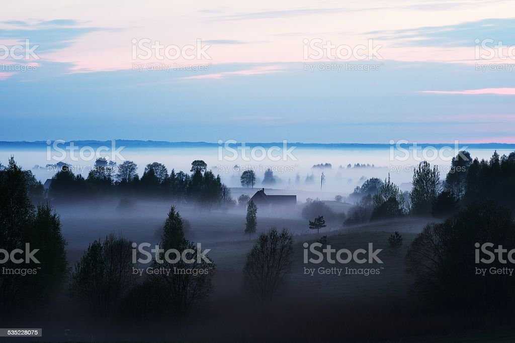 Fog covered valley stock photo