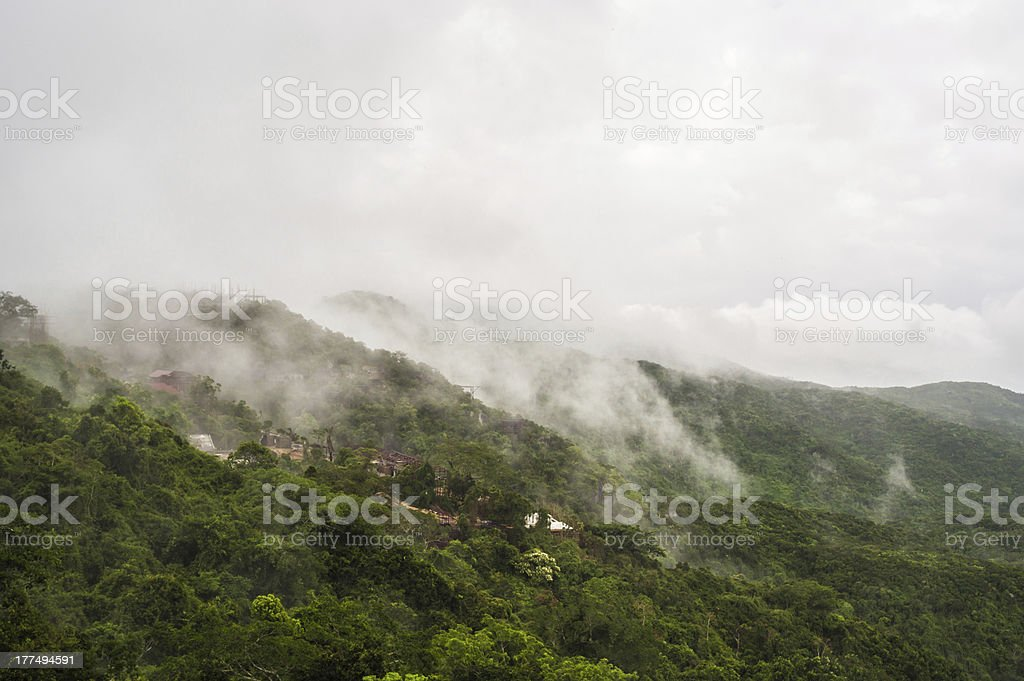 Fog covering mountains in the Hainan island, China stock photo
