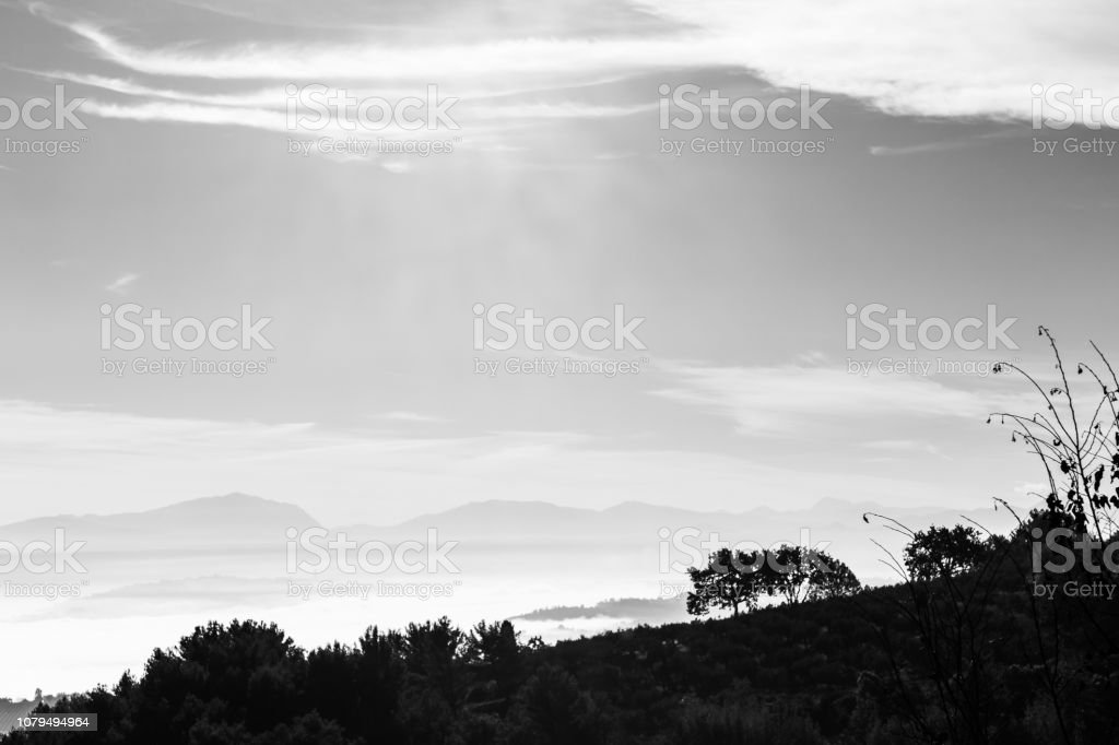 Fog filling a valley in Umbria (Italy), with layers of mountains and hills stock photo
