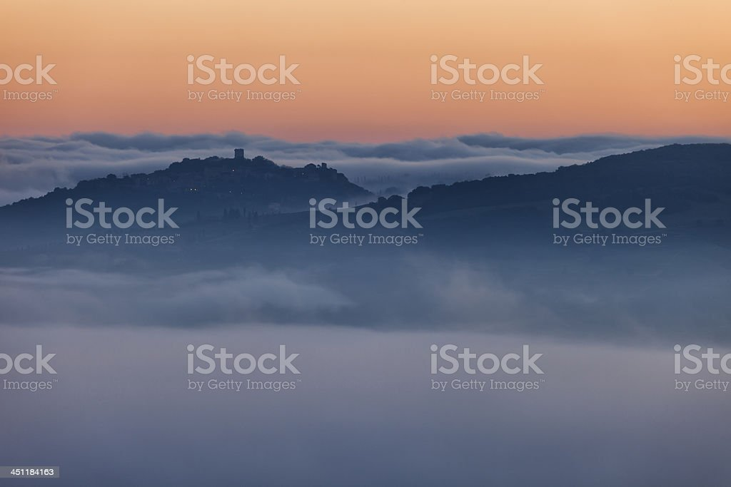Fog in Tuscan Valley, Early Morning Before Sunrise royalty-free stock photo