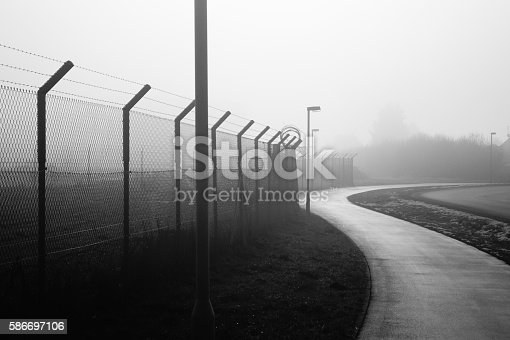fence on the airport, black and white photography, fog landscape