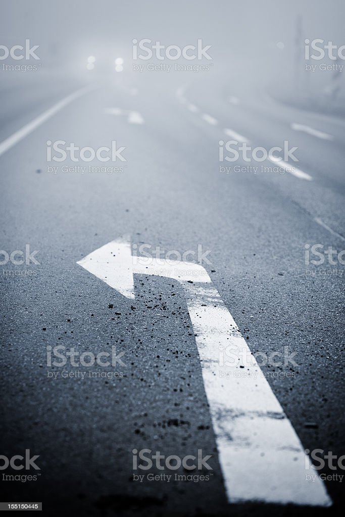 Fog on the country road, oncoming traffic royalty-free stock photo